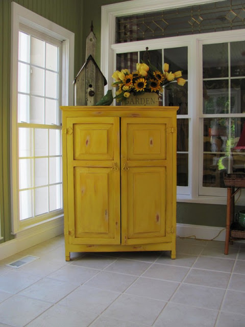 Yellow TV cabinet